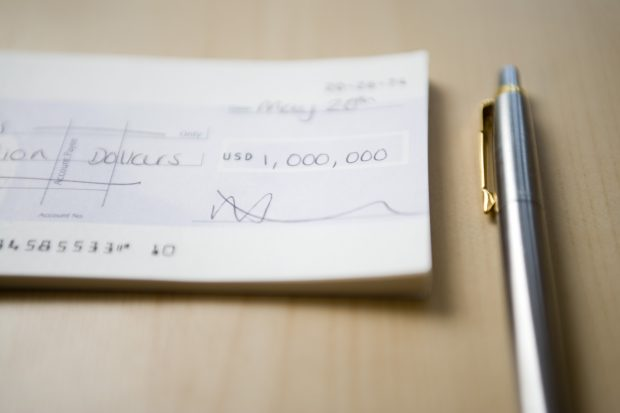 One million dollars cheque - schoolteacher first million dollars cheque