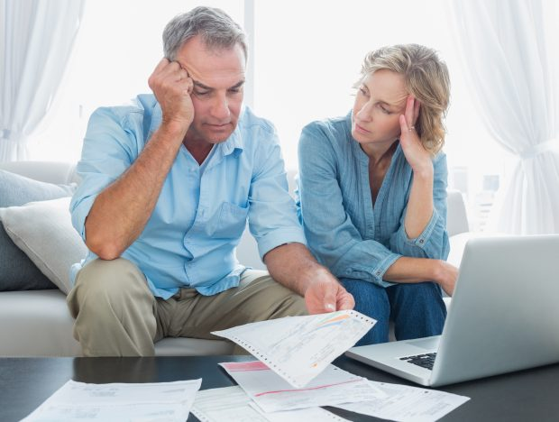 Image of a couple worried about their bills - Shows that budgeting is not the way to say Goodbye to Money Stress