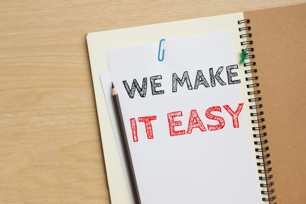 "Image of a notepad with ""we make it easy"" written on it - Represents that our method makes it easy to kiss money stress goodbye"